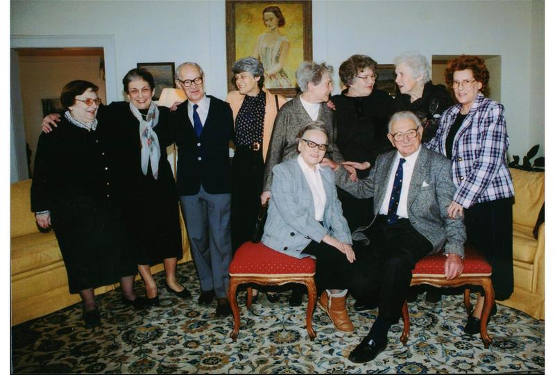 Sir Nicholas Winton , seated at right, with several of the grown children he rescued.