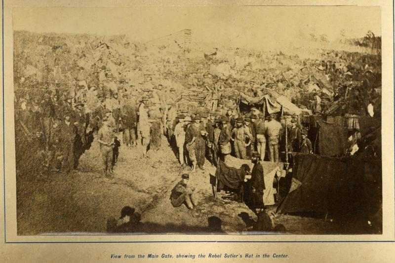 Andersonville: View from the Main Gate. Photograph by sn unidentified Confederate photographer, 1864. This view shows Union prisoners milling about near the main gate.
