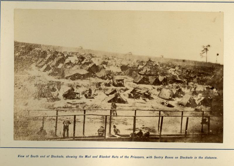 Andersonville: Southern end of the Camp. Photograph by sn unidentified Confederate photographer, 1864. This view shows the crude blanket huts used by many prisoners.