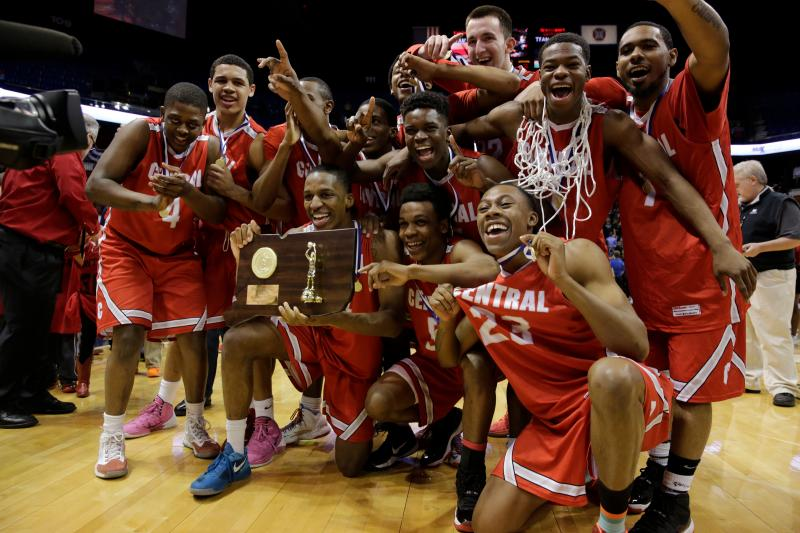 The Bridgeport Central Hilltoppers celebrate after defeating the Fairfield Prep Jesuits in the championship game of the 2014 CIAC Basketball Tournament at Mohegan Sun Arena. Bridgeport Central defeated Fairfield Prep.