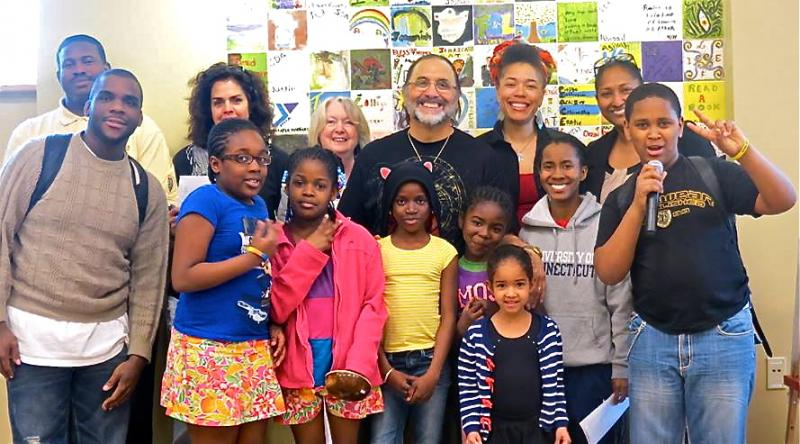 Poet John Stanizzi, at center, with Hartford Loves Poetry participants at Hartford Public Library Albany Branch.