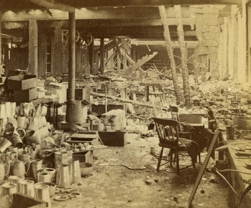 Ruins of a Portion of the Meriden Britannia Works. Photograph by Prescott & White, 1870.  This view of one of the damaged floors shows a workbench still in place.