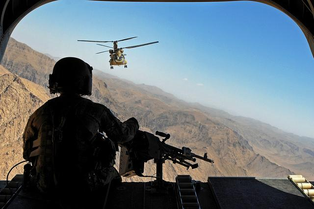 Sgt. Zach Smola, rear door gunner on a CH-47, keeps watch on the mountains in Uruzgan province, Afghanistan, May 12, 2013. The Chinooks operated by members of Bravo Company, 2nd Battalion, 104th Avia. Regiment from the CT and PA Army National Guards