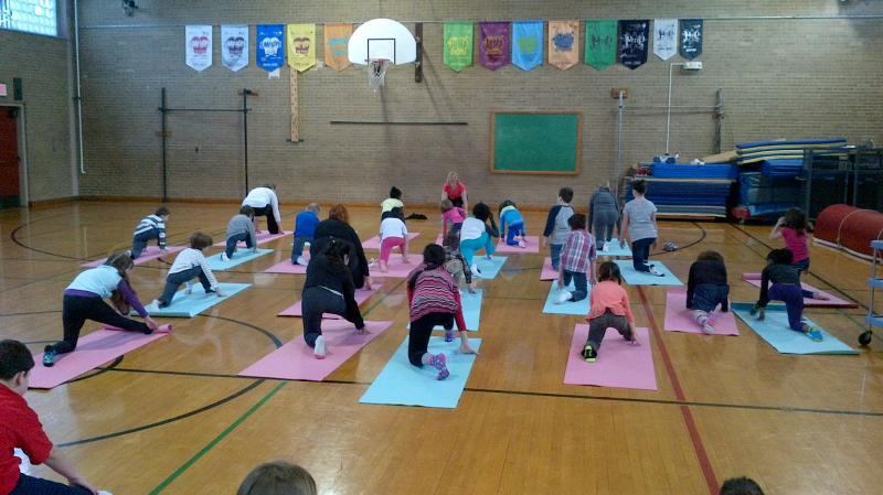 Students and parents practice yoga before class at West Hartford's Webster Hill Elementary School