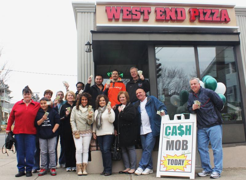 Bristol Rising supporters gathered outside West End Pizza, before the start of the cash mob.