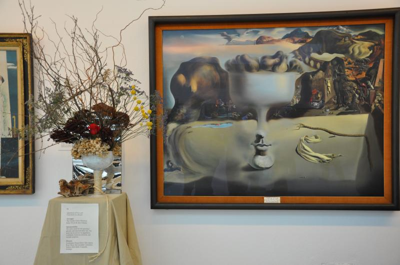 "Katie Nixon and Amy Schuster of The Garden Club of Hartford were inspired by Salvador Dali's ""Apparition of Face and Fruit-Dish on a Beach""."