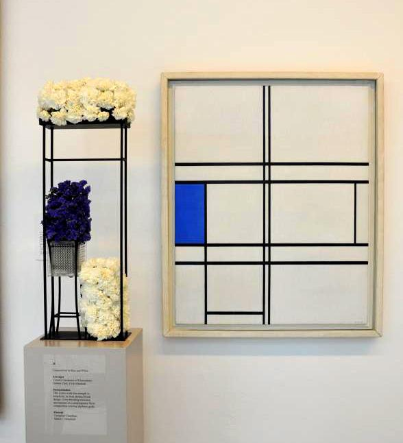 "Trish Manfredi of The Country Gardeners of Glastonbury Garden Club created this floral arrangement inspired by Piet Mondrian's ""Composition in Blue and White"""