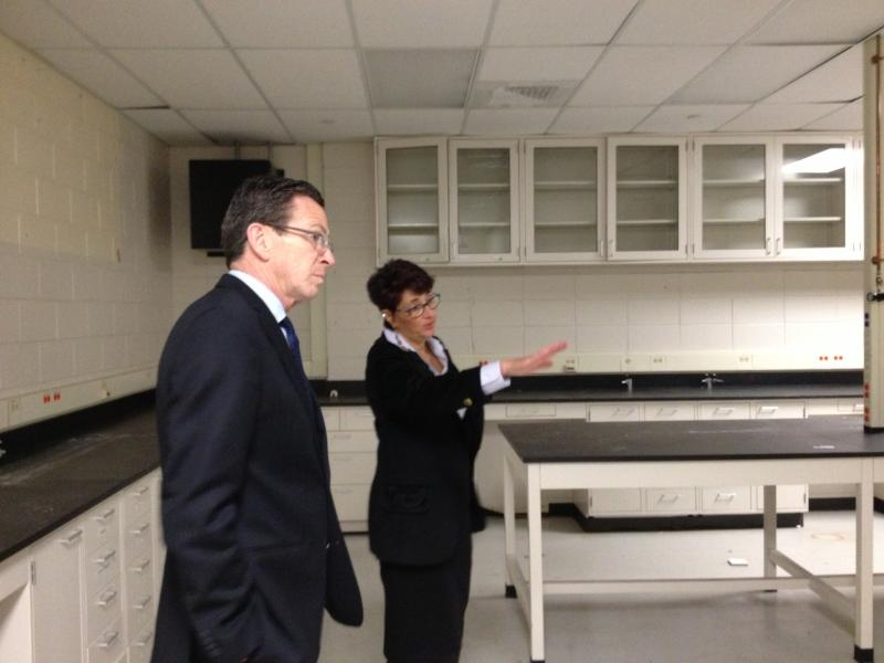 CURE's Susan Froshauer gives Gov. Dannel Malloy a tour of the unused labs.