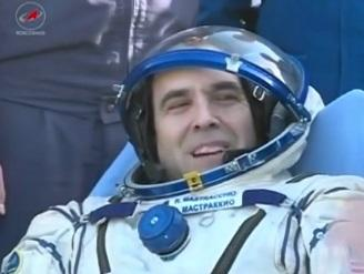 Back on the ground, and experiencing gravity for the first time in six months, Mastracchio receives medical attention.