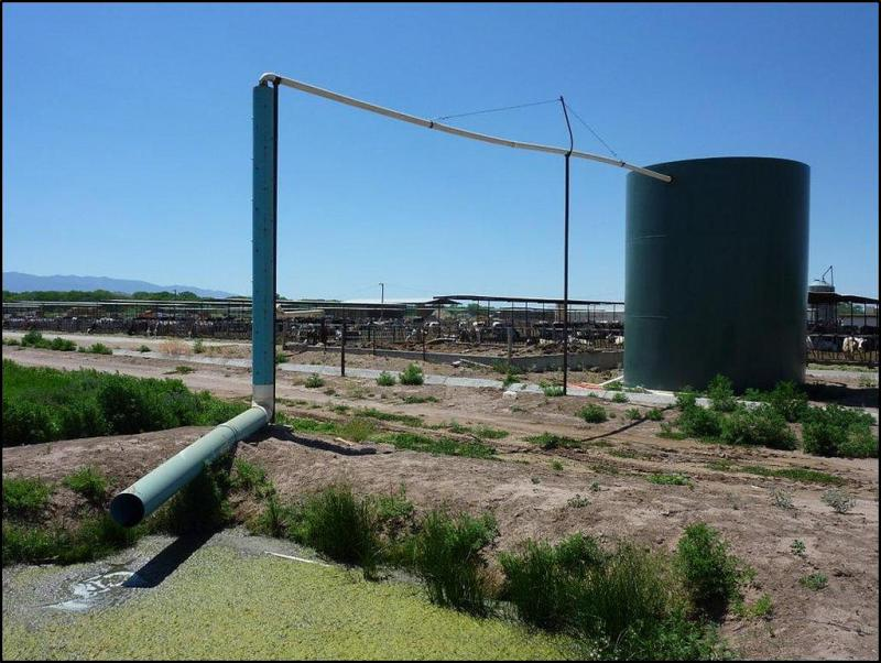 An anaerobic digester in New Mexico, at the Jarratt Dairy. It has a discharge pipe that feeds into a wetland.