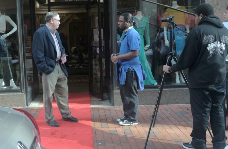 Student David interviews Stuart Miller on Pratt Street.