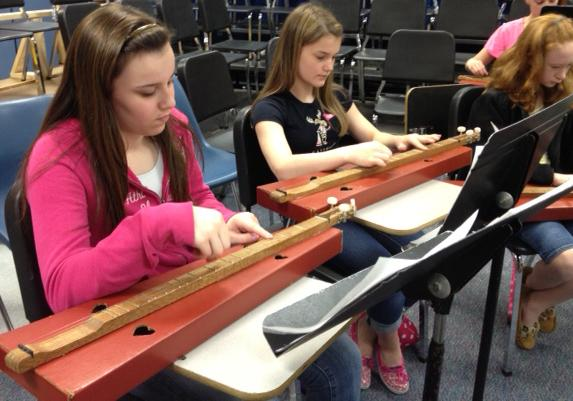 Students at the Middle School of Plainville play dulcimers in teacher Laurel Schwartz's class.