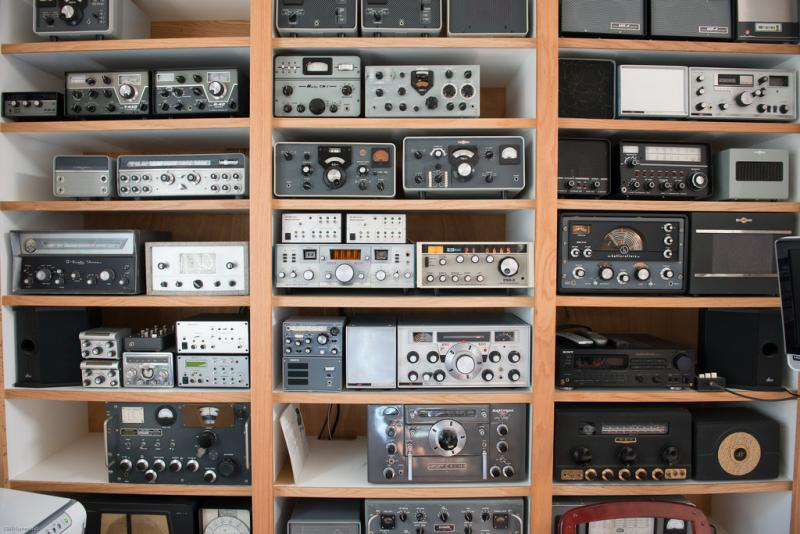 A wall of old ham radio rigs.