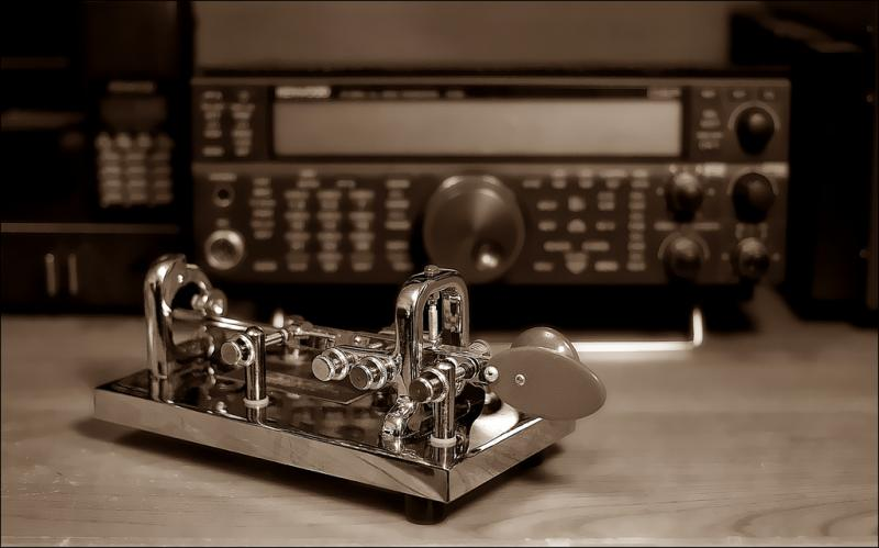 A telegraph machine in foreground.