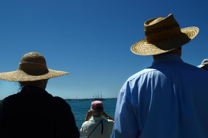 At Groton Point in Ct. many people protected themselves from the brilliant sun with widebrim 19th Century style hats as they lined the beaches trying to get a glimpse of the passing by Charles W. Morgan. At this point in the journey to ship turned away