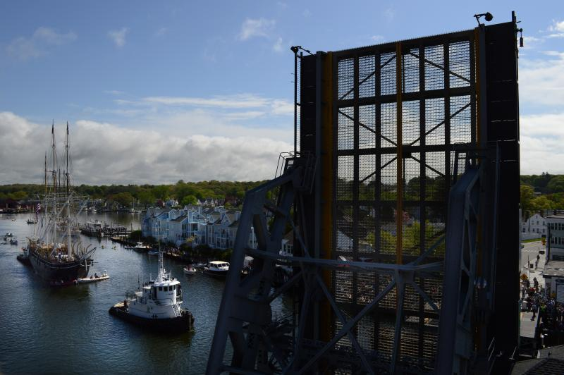 The historic drawbridge through the center of Mystic raises as the Charles W. Morgan whaling ship moves down the Mystic River on its way to New London, Ct.  Hundreds of people lined the shore and joined the docks to wish the crew and ship good luck.