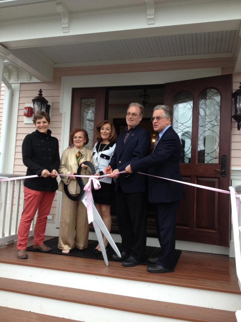 The Tagliateli family cuts the ribbon on Three Stories.