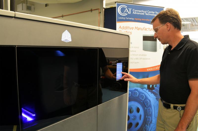 Machining Applications Specialist Eric Wold uses the new ProJet printer.