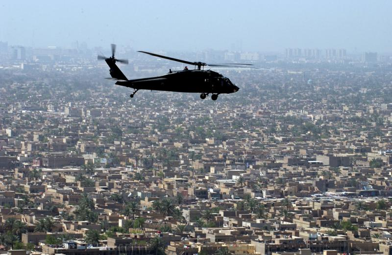 U.S. Army Black Hawk helicopter flies over Baghdad, Iraq on June 15, 2007.