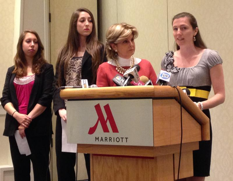Attorney Gloria Allred, at center, with UConn graduate Kylie Angell at the podium, and other plaintiffs in the sexual assault federal lawsuit against UConn.
