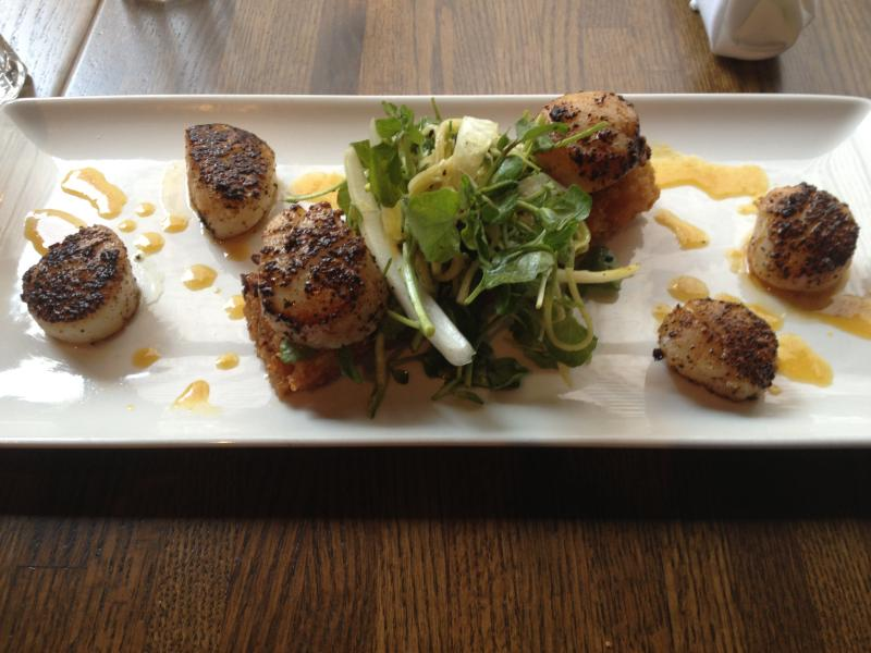 A sample meal from Trumbull Kitchen. Scallops, zucchini, and sticky rice with soy and orange glaze. Each meal component is from a different part of Connecticut.