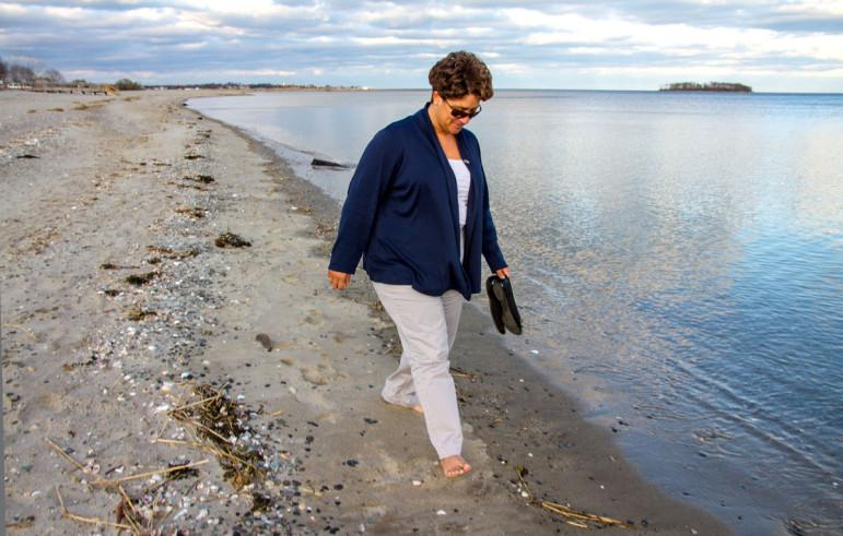 After work, Eunice Ramirez finds comfort in a walk at Walnut Beach, Milford.