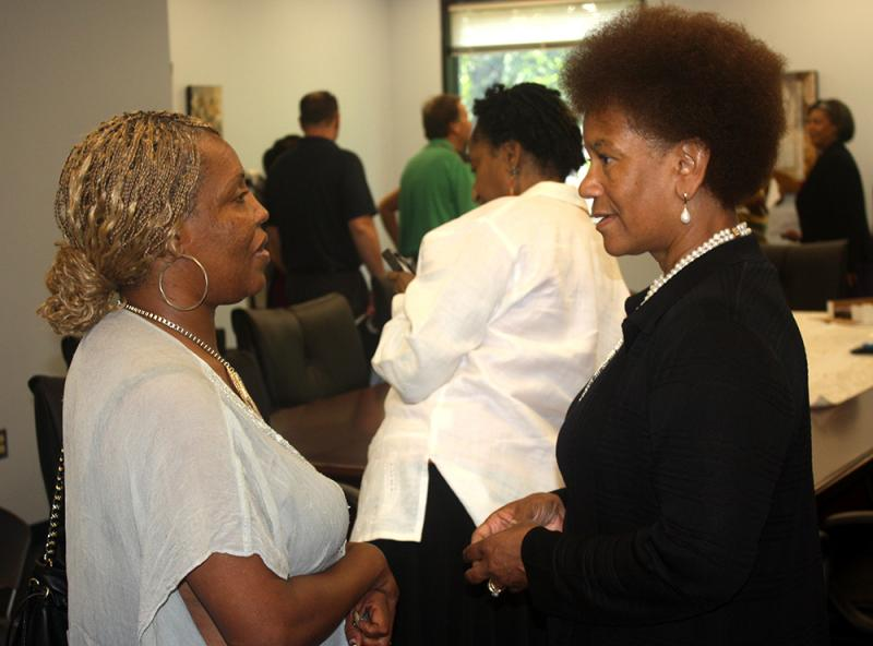 Support Court participant Rosa, left, with U.S. District Judge Vanessa Bryant.