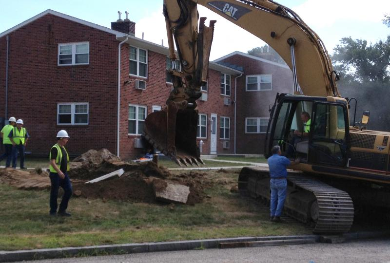Workers in New London repair a water main leak on Thursday.