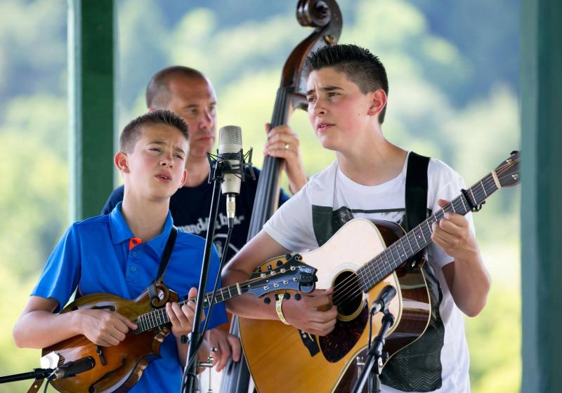 The Zolla Boys, Sam, left, and Ben, perform at the Jenny Brook Bluegrass Festival in Vermont. They're from the northwest corner of Connecticut and perform at the Podunk Bluegrass Festival.