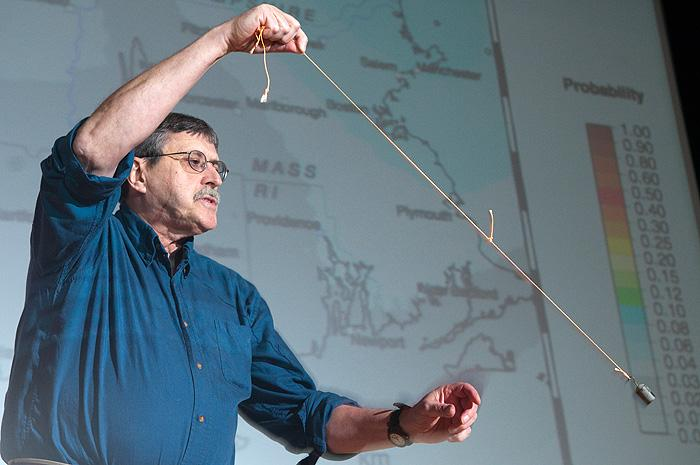 UConn geophysics professor Vernon Cormier said seismic activity in and around Deep River has been reported since colonial times. Here he demonstrates how the sway of buildings in an earthquake is like an upside-down pendulum motion.