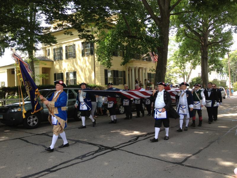 The Stonington Battle Flag is carried in the parade marking the bicentennial of the conflict