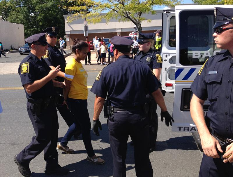 A protester is arrested in Hartford on Washington Street.
