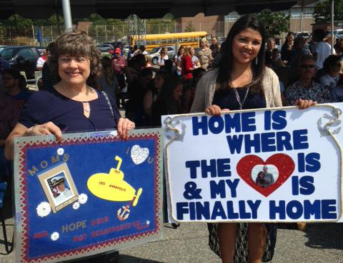 Glenda Caprini and her daughter-in-law waiting for her son, Casey, a sailor who serves on USS Annapolis.