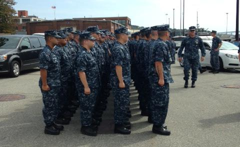 Submarine school sailors wait to greet the crew of the USS Annapolis.