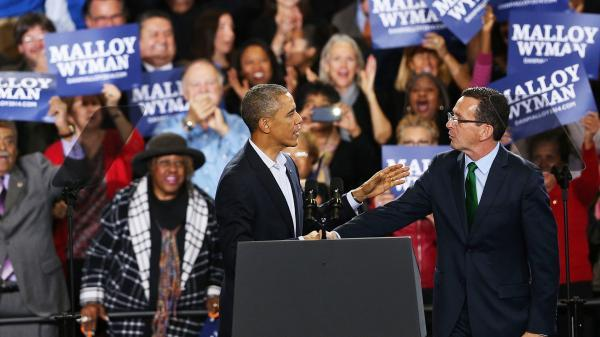 President Obama stands with Connecticut Gov. Dan Malloy in Bridgeport on Sunday.