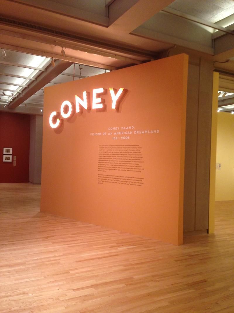 "Entering ""Coney Island: Visions of an American Dreamland, 1861-2008,"" viewers pass lumious bulbs reading ""Coney"" and proceed into a variety of colorful and interactive rooms outlining the five eras of Coney Island's history."