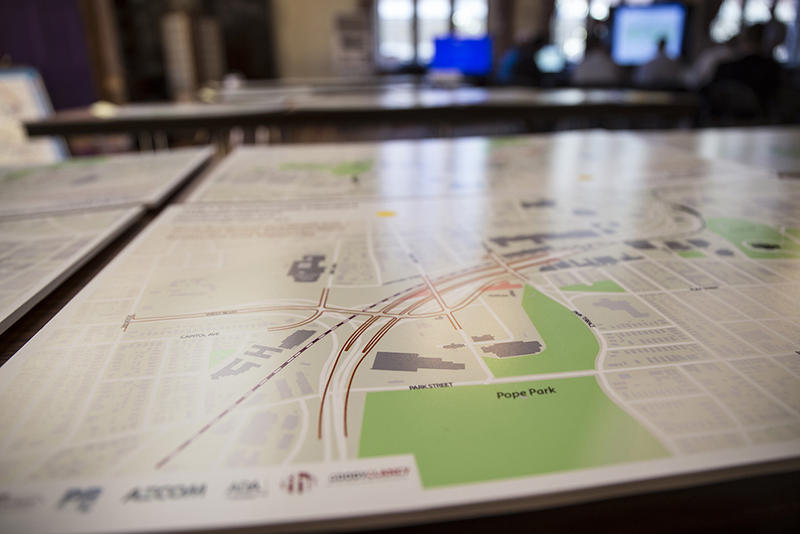 A map showing I-84's path through Hartford at an open house and planning session.