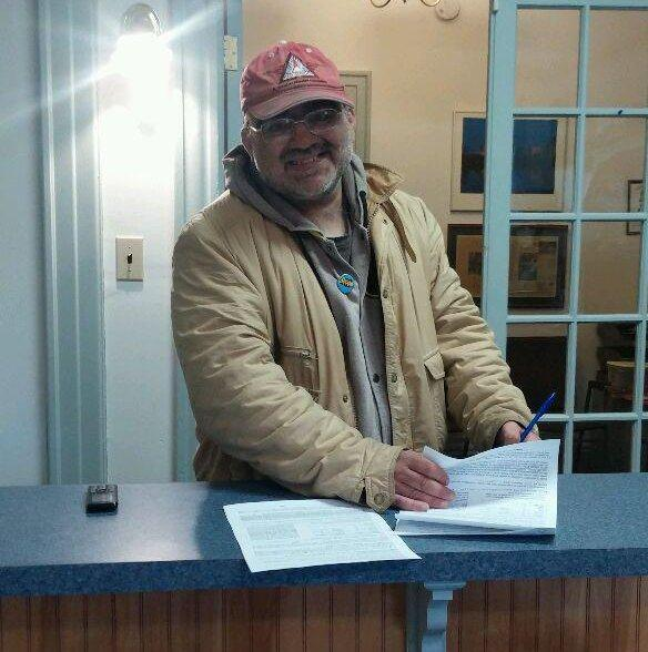 Sal Pinna signing the lease for his new apartment in Hartford.