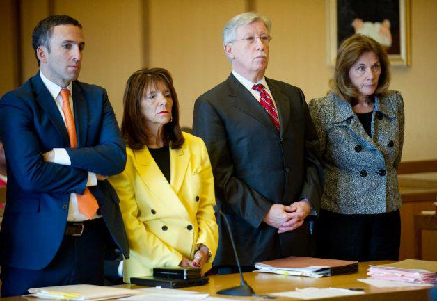Former Stamford High School Principal Donna Valentine, in yellow, and Assistant Principal Roth Nordin, right, appear in court last November with their lawyers, Mark Sherman, and Fred O'Brien.