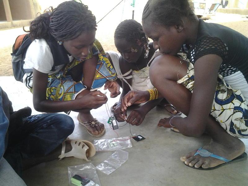 Girls in Mali work on their solar-powered lights.