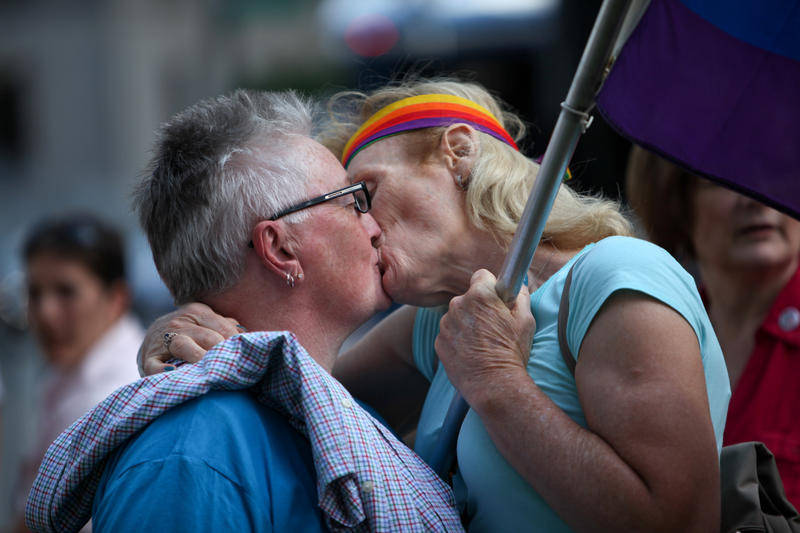 A large crowd gathered on the back lawn of the Old State House for the Hartford Capital City Pride Rally on Friday, the same day the U.S. Supreme Court ruled that same-sex marriage was legal in all 50 states.