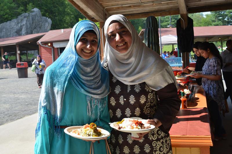 Two women enjoy Eid Carnival at Lake Compounce.