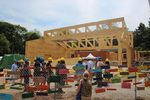 Common Ground students, teachers, and supporters head inside the construction fence to learn about the sustainable structure for Common Ground's new building
