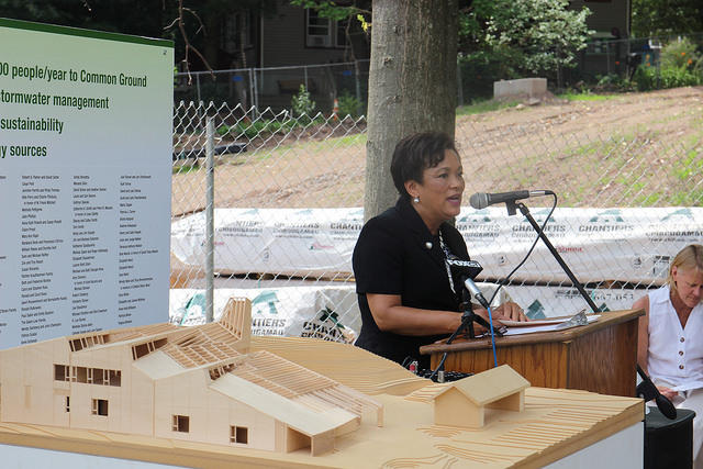 New Haven Mayor Toni Harp, with a 3-D model of the new building in the foreground.
