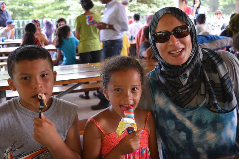 Children enjoy ice cream at the Eid Carnival.
