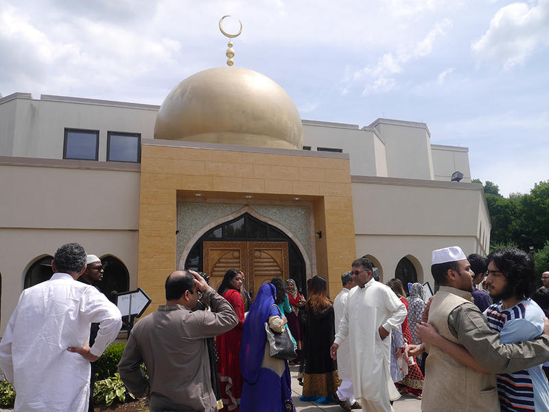 """Outside the Berlin mosque, Muslims give warm greetings and wish one another """"Eid Mubarak."""""""
