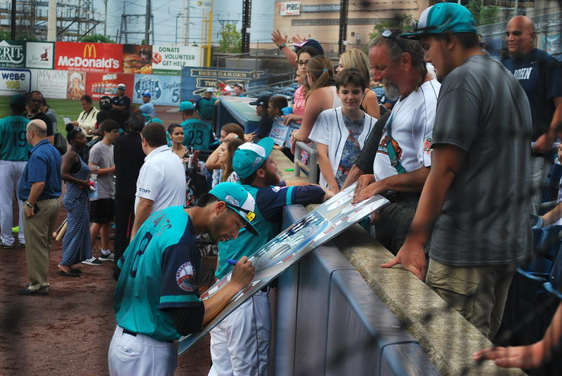Camden Riversharks shortstop Brandon Chaves signs autographs before the game.