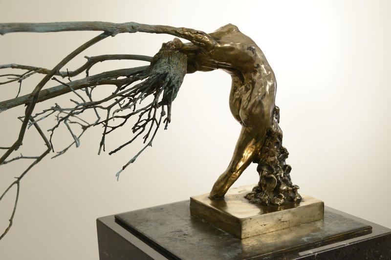 """Swept Away,"" bronze on marble sculpture by Renee Rhodes."