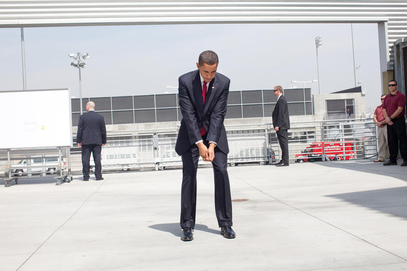 President Barack Obama practices his golf swing at an outdoor hold prior to an event in Los Angeles, California in 2009.