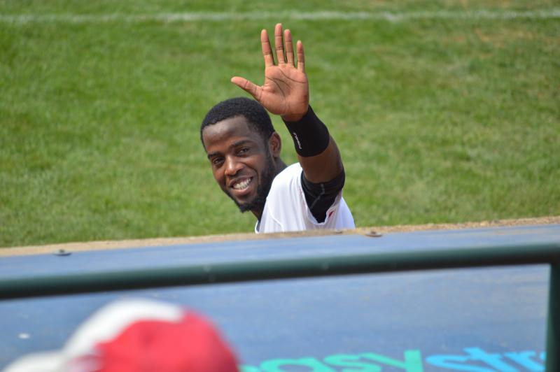 Second baseman Juan Ciriaco waves to fans.